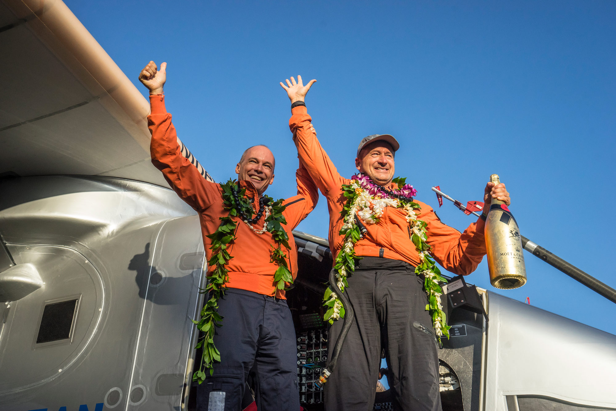In Hawaii, Bertrand Piccard and André Borschberg celebrate winning the world record for the longest solo flight ever flown.
